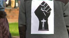 Protest, Occupy (Wall-Street) Seattle  logo jacket zoom Stock Footage