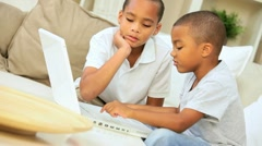 Little Ethnic Boys with Laptop on Sofa - stock footage