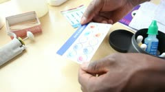 Medical technician testing blood samples in laboratory. Kenya, Africa. Stock Footage