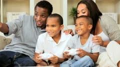 Ethnic Family Using Home Games Console Stock Footage