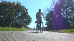 Two women on bikes passing by 03 Stock Footage