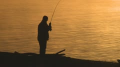 P01762 Man Catching Fish and Sunrise Stock Footage