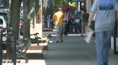 People walking down sidewalk along store fronts (1 of 3) Stock Footage