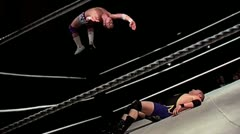 Wrestling backflip off top rope, knees to face, pain & screaming - stock footage