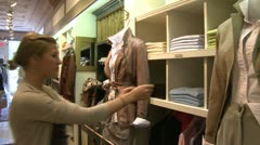 Shopping in a country clothing store (1 of 2) Stock Footage