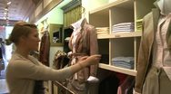 Stock Video Footage of Shopping in a country clothing store (1 of 2)