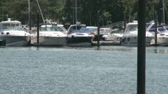 Boats moored along a dock. Stock Footage