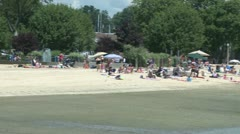 People on the beach with umbrellas. Stock Footage