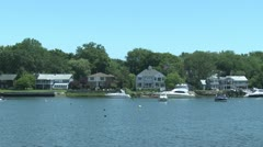 Boats moored in front of homes Stock Footage