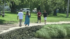 People walking along the bank (1 of 4) Stock Footage