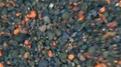 Small parts of volcanic rocks dispersed from interior to exterior of the frame Stock Footage