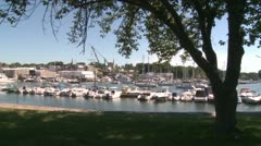 A small harbor with docked boats. (1 of 2) Stock Footage