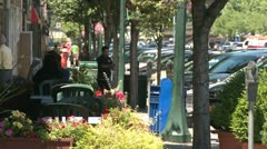 A small sidewalk cafe.  (2 of 2) Stock Footage