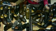 Stock Video Footage of People choose shoes at stall,Various varieties of styles.