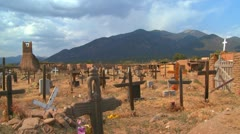 Christian graves and crosses in the Taos pueblo cemetery. Stock Footage