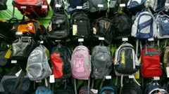 Many backpack on the counter at mall. - stock footage