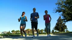 Young Friends Jogging Together Stock Footage