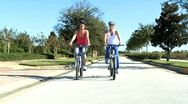 Stock Video Footage of Caucasian Female Friends Cycling on Suburban Roads