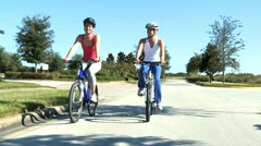 Healthy Female Friends Cycling Together Stock Footage