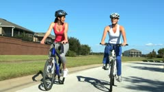 Young Females Keeping Fit and Healthy Cycling Stock Footage