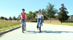 Fit Young Female Friends Cycling Together Stock Footage