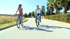 Female Friends Cycling Together Stock Footage