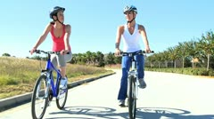 Female Friends Cycling Fun Together Stock Footage