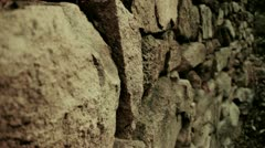 Stone wall and winding lane in mountain. Stock Footage