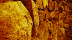 Shine golden sunlight on stone wall in mountain. Stock Footage
