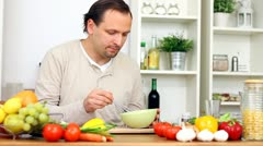 Happy man cooking in the kitchen Stock Footage