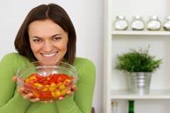 Young woman showing a salad in the kitchen - stock footage