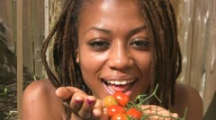 Girl eats tomatoes. Stock Footage