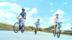 Caucasian Family Group Cycling Outdoors - stock footage