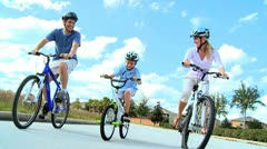 Healthy Young Family Enjoying Cycling Together Stock Footage