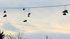 Sneakers hanging on electrical wires Stock Footage