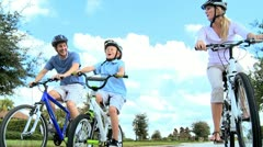 Young Caucasian Family Cycling Together - stock footage