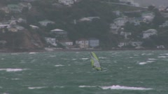 Windsurfers crossing a bay Stock Footage