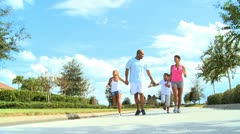 Healthy Young Ethnic Family Jogging Together - stock footage