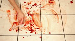 Cleaning blood from kitchen tile with knife laying Stock Footage