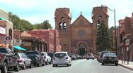 Stock Video Footage of Establishing shot of downtown Santa Fe, New Mexico with St. Francis basilica.