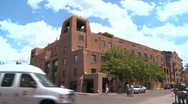 Stock Video Footage of Establishing shot of downtown Santa Fe, New Mexico with adobe buildings.