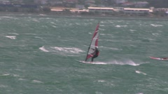 Windsurfers Race Away From Camera Stock Footage