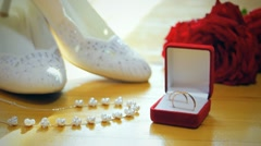 wedding composition, rings, bride shoes - stock footage