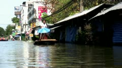 Thai Man On A Raft Passes Boat During Floods In Bangkok Stock Footage