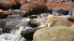 Stream runs over rocks Stock Footage