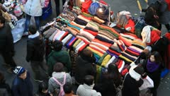 People shopping muffler on downtown street - stock footage