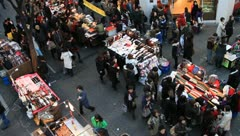 Crowds of people around street market on downtown - stock footage