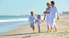 Happy Caucasian Family Splashing in Ocean Shallows Stock Footage