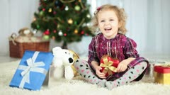 Laughing girl 3 years age near Christmas Tree Stock Footage