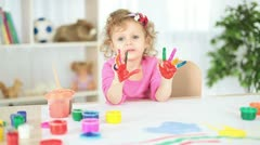 Girl with hand painted in colorful paints Stock Footage